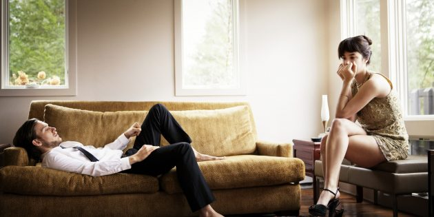 Unhappy Couple In Living Room