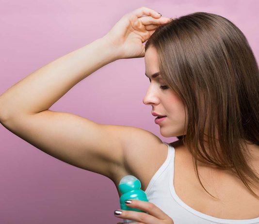 woman uses deodorant